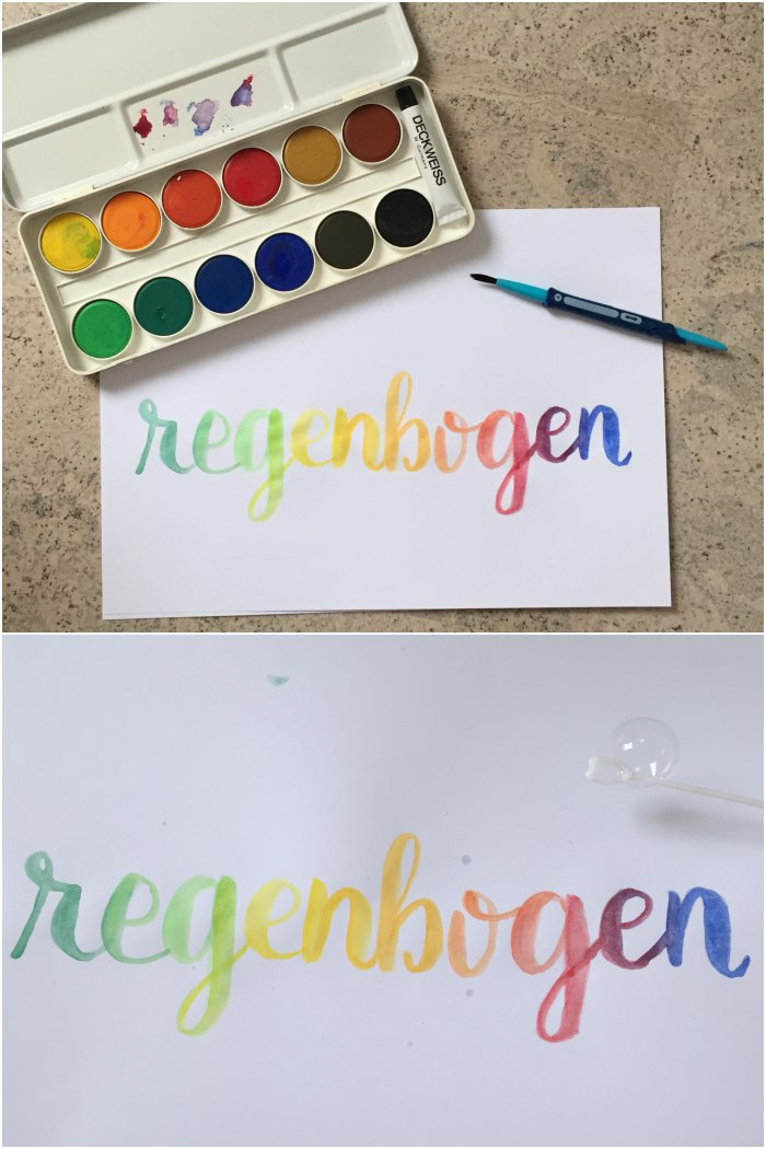 Das Wort Regenbogen mit Wasserfarben gelettert